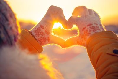 hands in heart shape show loving kindness