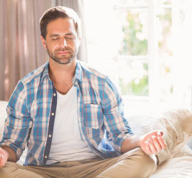 man with Asperger's meditating