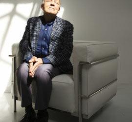 senior man with eyes closed meditating