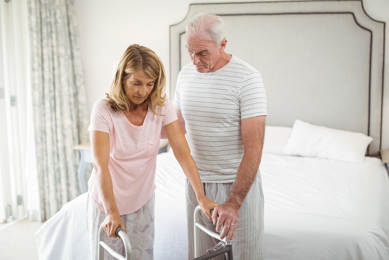 senior man and women coping with health issues